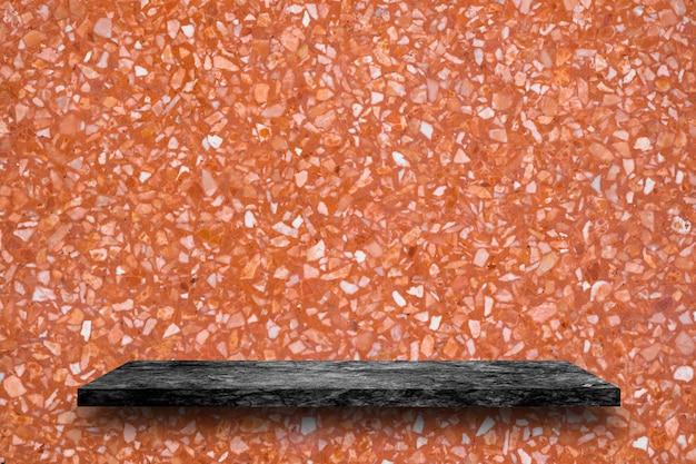 Czarny marmur kamień półki na tle lastryko