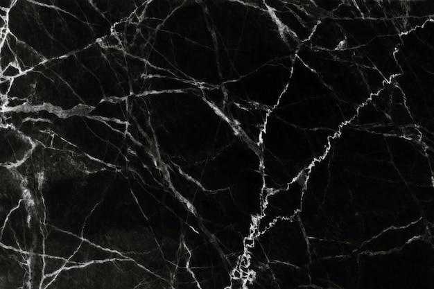 Czarny marmur tekstura z naturalnym wzorem w tle