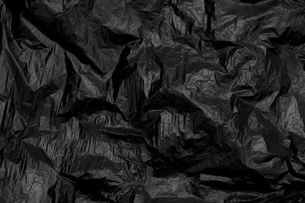 Czarny marszczący klingeryt dla tła i tekstury
