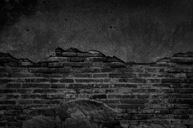 Czarny mur z cegły i tekstury betonu na tle.