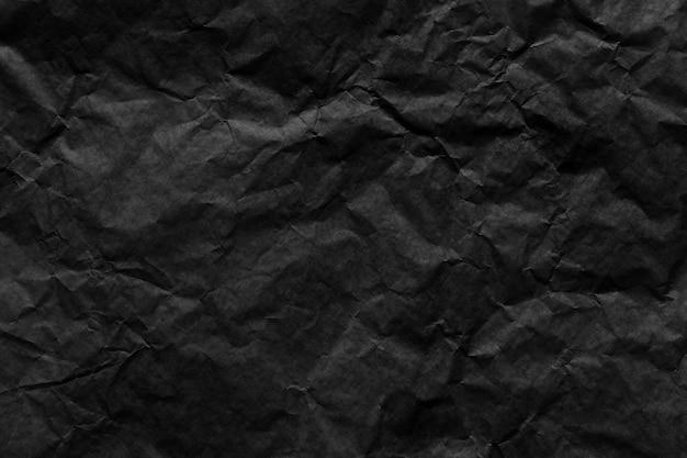 Czarny papier pomarszczony tekstura tło dla projektu w koncepcji pracy.