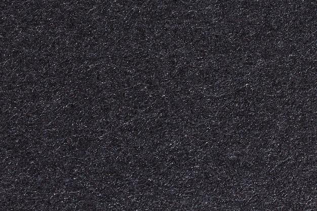 Czarny papier tekstury lub tła. zdjęcie w wysokiej rozdzielczości.