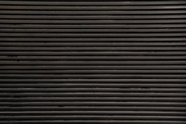 Czarny pasiasty ścienny tekstury tło