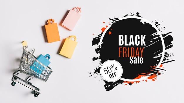 Czarny piątek koncepcja koszyk na zakupy
