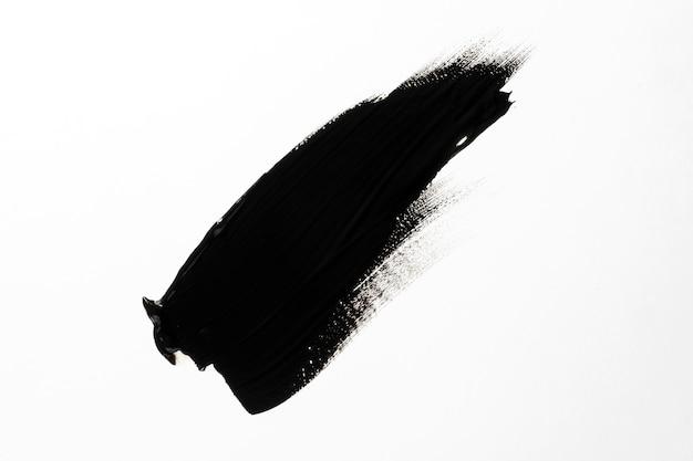 Czarny pociągnięcie pędzla na białym tle