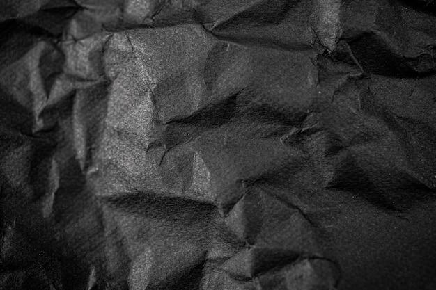 Czarny pomarszczony papier tekstura tło.