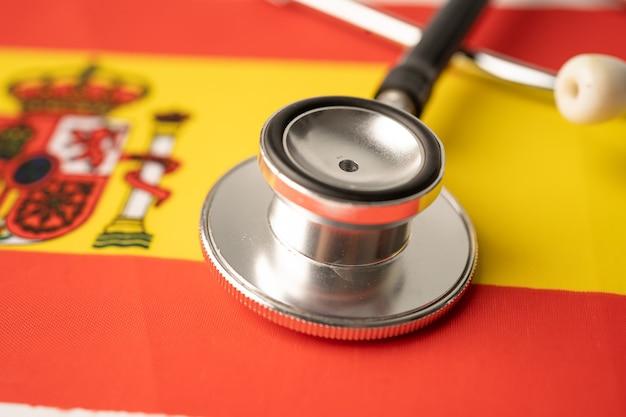 Czarny stetoskop na fladze hiszpanii.