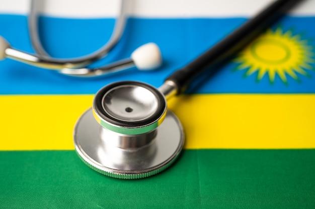 Czarny stetoskop na fladze rwandy.