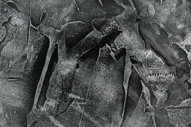 Czarny stiuk z metalicznymi plamami. ciemnoszara tekstura objętościowa.