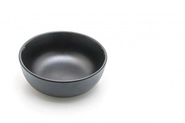 Czarny talerz i miska na białym tle