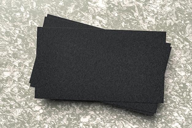 Czarny tekturowy stos wizytówek do znakowania firmowego - renderowanie 3d