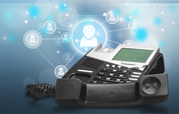 Czarny telefon biurowy z jasnymi cyfrowymi ikonami 3d