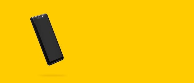 Czarny telefon na żółtym tle, zdjęcie panoramiczne