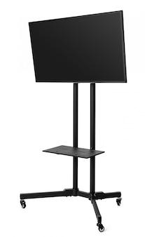 Czarny telewizor na metalu stojaku odizolowywającym na bielu