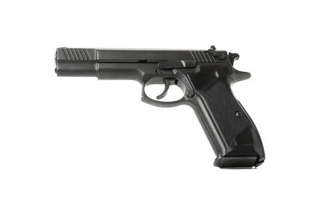 Czarny traumatyczny pistolet odizolowywający na bielu