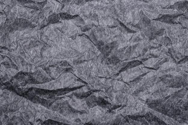 Czarny zmięty papier teksturowanej tło