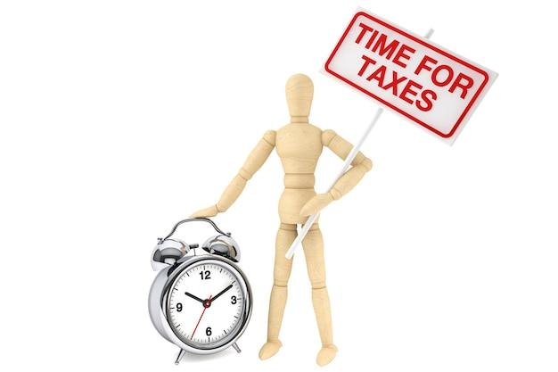 Czas na koncepcję podatków. drewniany manekin z banerem i budzikiem na białym tle