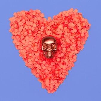 Czaszka w różowym konfetti serca. minimalna płaska sztuka świecenia cukierkowe kolory