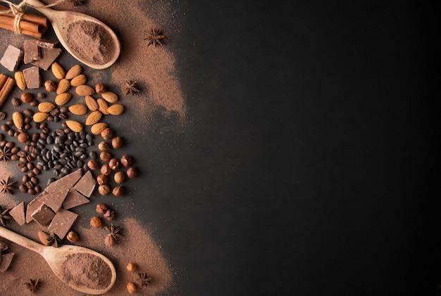 Czekolada z orzechami laskowymi, migdałami i kakao na ciemnym tle