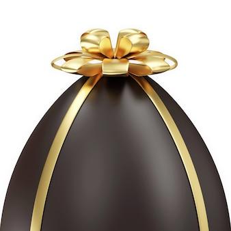 Czekoladowe jajko wielkanocne z kokardą złoty na białym tle