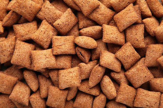 Czekoladowe płatki kukurydziane płatki zbliżenie tło. tekstura zbóż. widok z góry