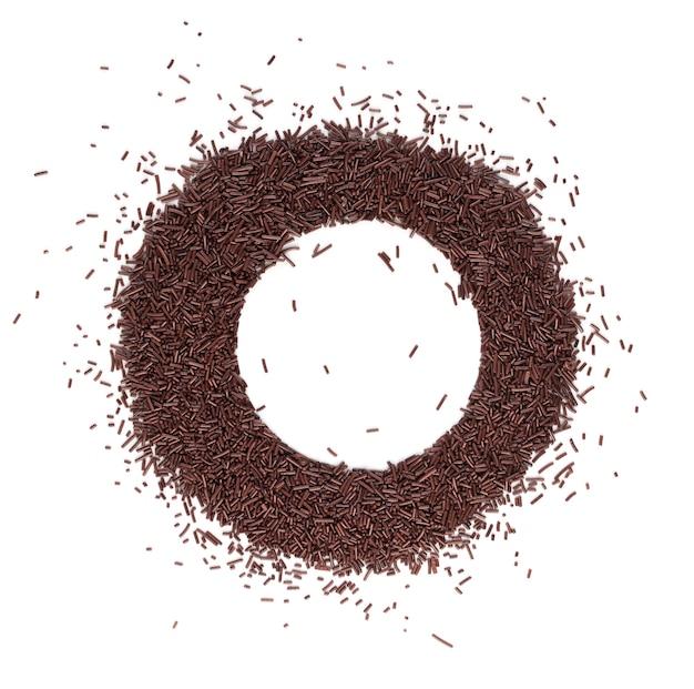 Czekoladowe posypki na białym tle widok z góry. dekoracja w słodkiej brązowej glazurze lub wermiszel czekoladowy