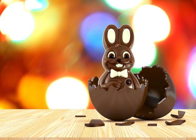 Czekoladowy królik wielkanocny w złamanej skorupce w rozmytych światłach bokeh