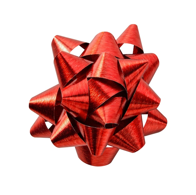 Czerwona błyszcząca wstążka łuk prezent na białym tle na sezonowe pozdrowienia wakacje i boże narodzenie