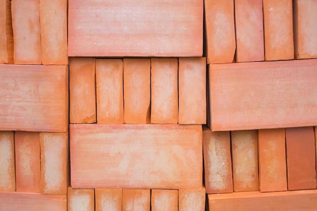 Czerwona cegła dla budowy tła lub tekstury.