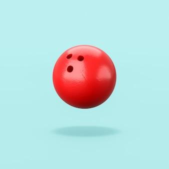 Czerwona kula do kręgli na niebieskim tle