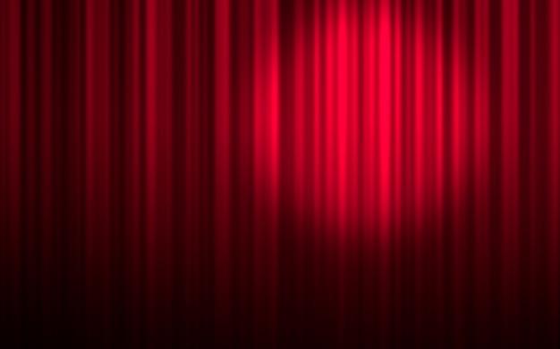 Czerwona kurtyna teatralna ze światłem reflektorów