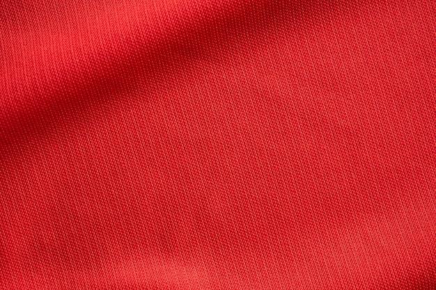 Czerwona odzież sportowa tkanina piłkarska tekstura z bliska
