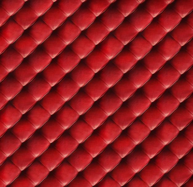 Czerwona pikowana skórzana tekstura z bliska