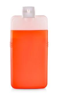 Czerwona plastikowa butelka z szamponem