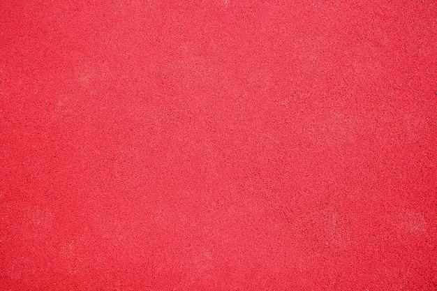 Czerwona powłoka gumowa tła placu zabaw, tekstura