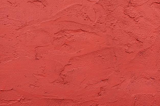 Czerwona ściana teksturowanej tło.