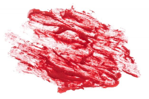 Czerwona szminka na białym tle