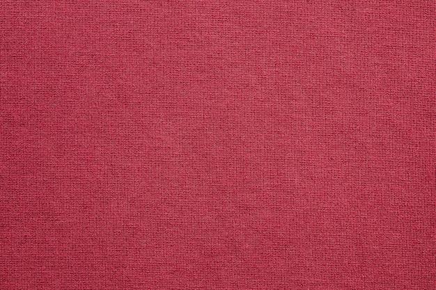 Czerwona tkanina odzieżowa tekstura wzór tła