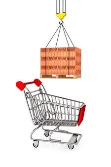 Czerwone cegły na drewnianej palecie z wózkiem na zakupy w supermarkecie na białym tle