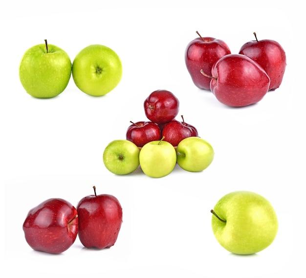 Czerwone i zielone jabłka na białym tle