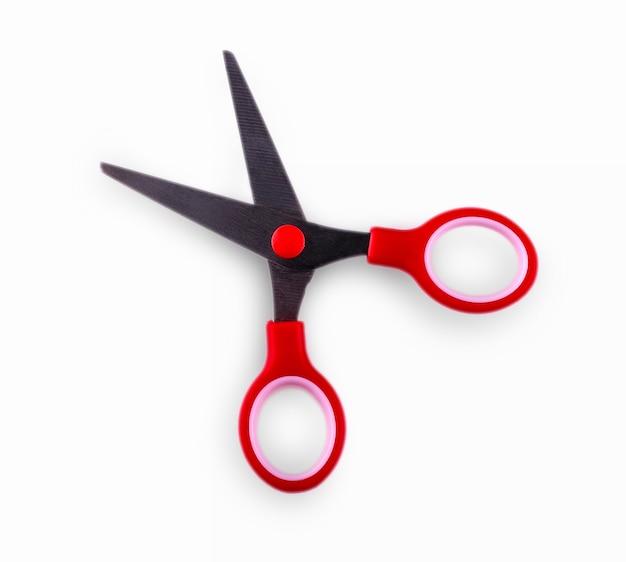 Czerwone nożyczki na białym tle.