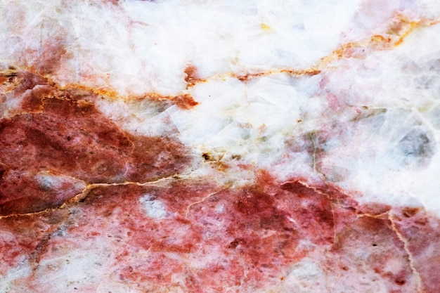 Czerwone pęknięte marmurowe teksturowane tło
