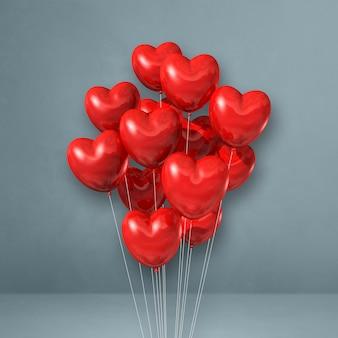 Czerwone serce kształt balony kilka na tle szarej ścianie. renderowania 3d ilustracji