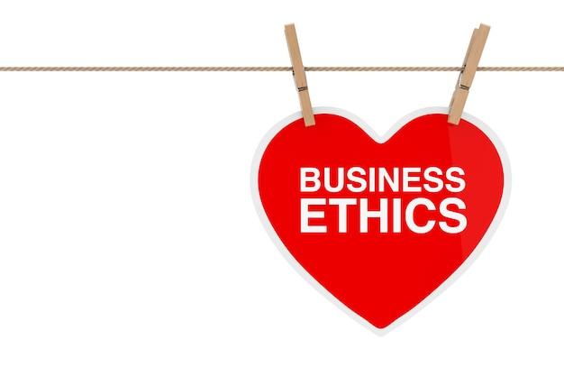 Czerwone serce papieru ze znakiem etyki biznesowej wiszące na liny na białym tle. renderowanie 3d