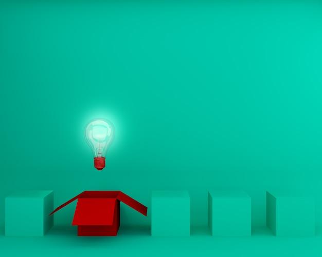 Czerwone światło żarówki jarzy się różną kreatywnie pomysł myśli outside pudełko na zielonym backgro