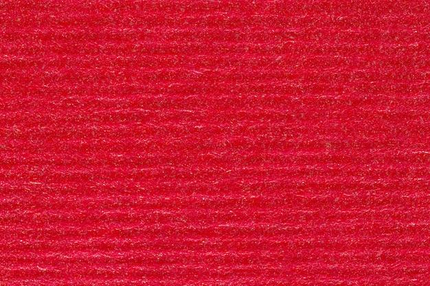 Czerwone tło pozbawione papieru, z bliska. zdjęcie w wysokiej rozdzielczości.