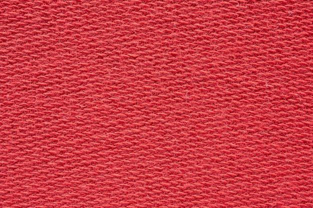Czerwone tło tekstury tkaniny z bliska