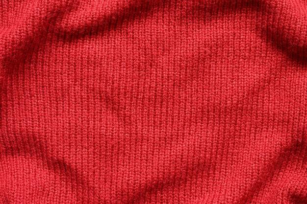 Czerwone tło z dzianiny wełnianej tekstury