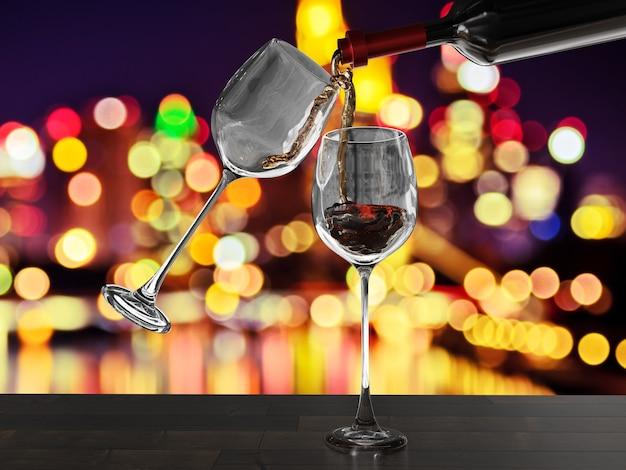 Czerwone wino przelewa się do dwóch kieliszków z tłem bokeh