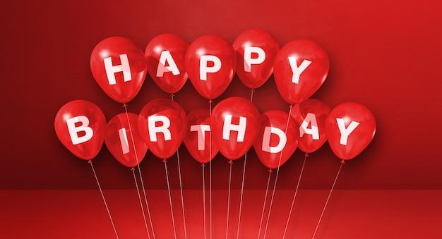 Czerwone wszystkiego najlepszego z okazji urodzin balony na czerwonej scenie powierzchni